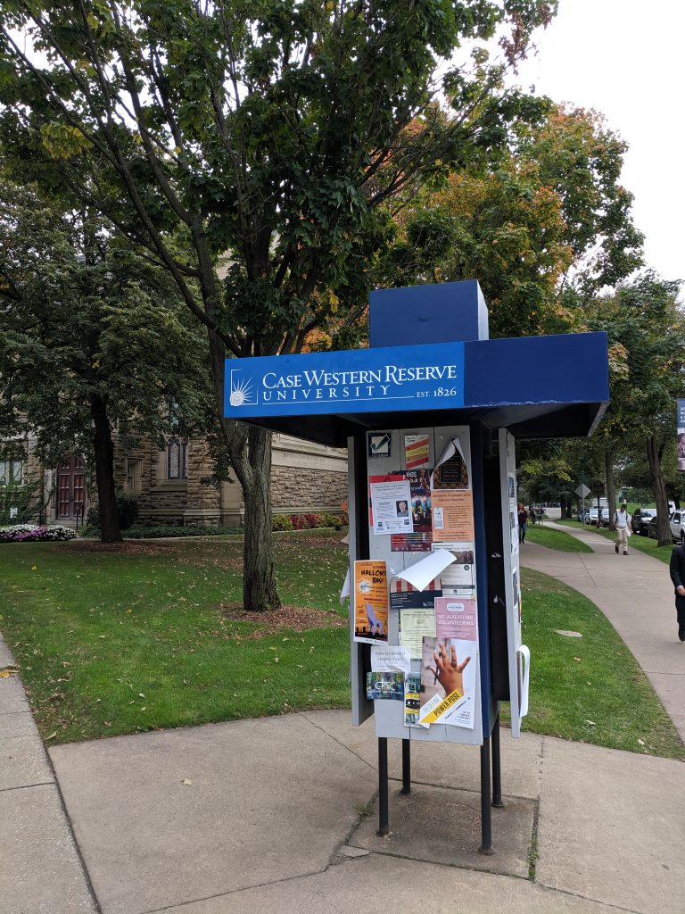 Kiosk with student flyers at Case Western Reserve University